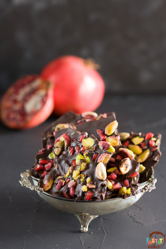 chocolate pomegranate bark in antique plate