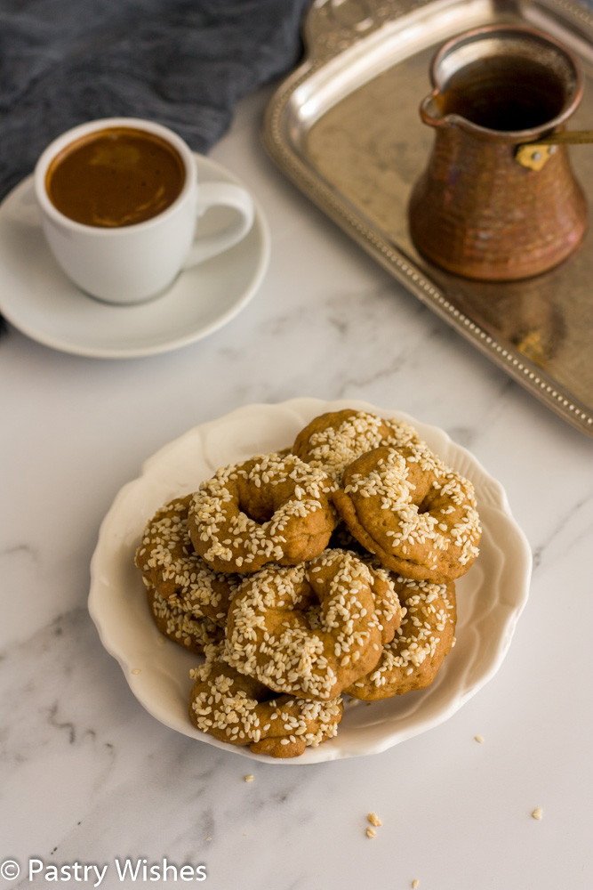 ladokoulooura greek olive oil cookies on a white plate with coffee in background