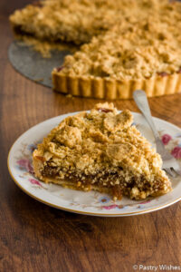 fig crumble tart on a plate and in background